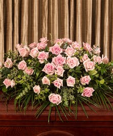 A beautiful display of pink Equadorian roses custom designed to grace the casket, a full five feet long.
