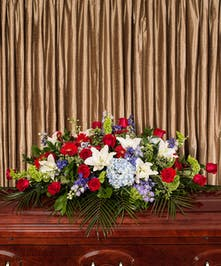 Part of our God Bless America collection, we honor your courageous loved one with our red roses, blue delphinium and fragrant white lilies, measuring 5' long.