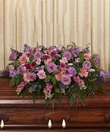 A beautiful soft pastel display custom designed to grace the casket measuring five feet long.