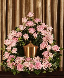 A beautiful display of pink Equadorian roses custom designed to grace the service, stands 18