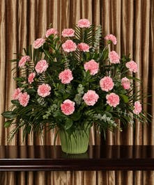 Part of our Best Value collection, send your condolences with style, pink carnations in elegant floor urn stands two feet tall.