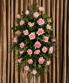 Classic standing easle created with lush pink roses, stands just over four feet tall.
