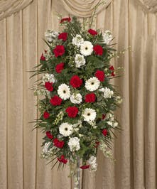 Red & white easle spray on a four foot stand.