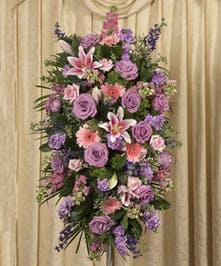 A beautiful soft pastel display custom designed to grace the service.