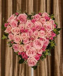 A beautiful display of pink Equadorian roses custom designed to grace the service. This delicate display measures 15
