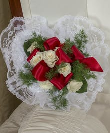 Red & white floral swag on satin heart pillow.