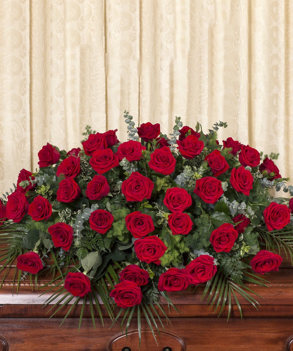 Red rose casket a beautiful display of red equadorian roses custom designed to grace the casket designed at five izmirmasajfo